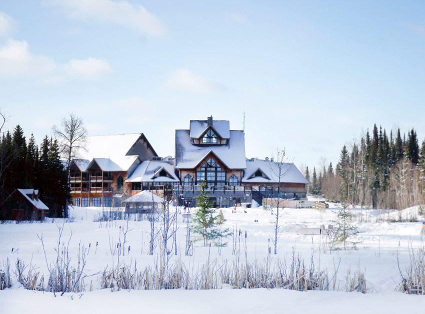 View of Elk Ridge Resort building in winter