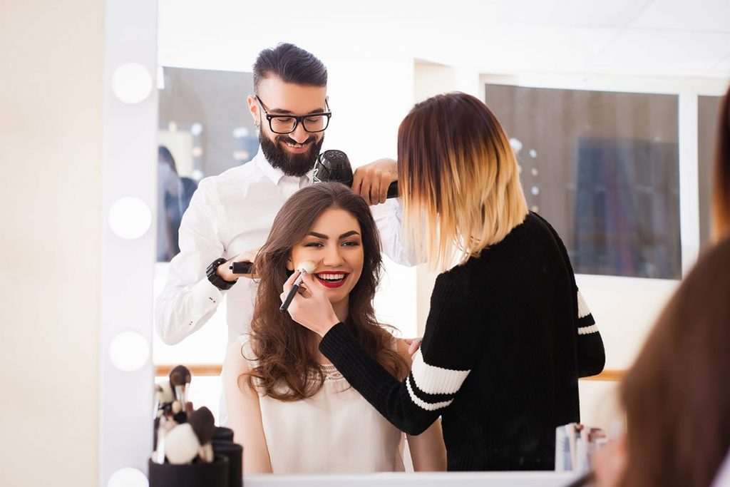 Lady at beauty salon gets makeup and hair styled