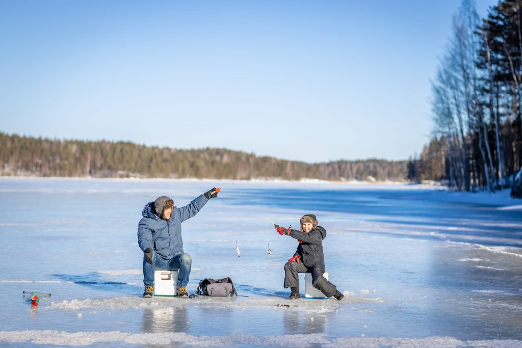 A child and dad ice fishing
