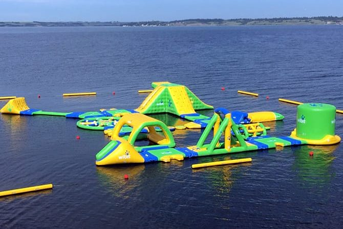 View of inflatable outdoor waterpark on a lake