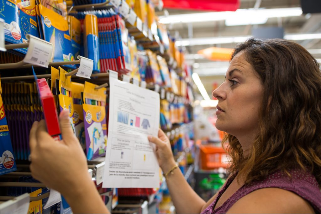 Woman looking at school supplies in store.
